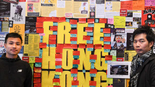 A poster wall covered in messages supporting democracy in Hong Kong at the University of Technology, Sydney