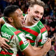 Rabbitohs winger Taane Milne (left) celebrates a try with Blake Taaffe.