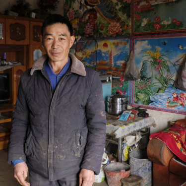 Xia Dongqiao, 49, in his home in Zhuanshanbao, a village in Ludian County, Yunnan.