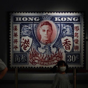 A poster of a British Hong Kong postal stamp featuring the picture of King George VI, is displayed at the Hong Kong Story exhibition.