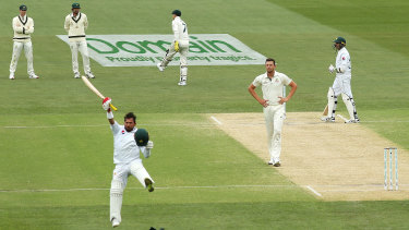 A jubliant Yasir Shah celebrates his century at Adelaide Oval.