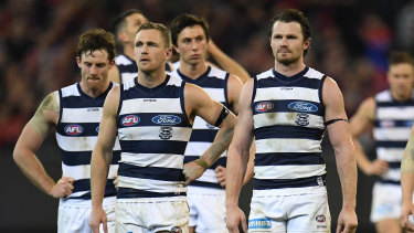 Low point: Joel Selwood and Patrick Dangerfield lead the Cats from the field after their elimination final loss to Melbourne in 2018.