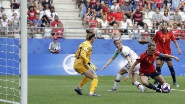Goal-mouth scramble: Spain's Irene Paredes, right, defends against Rapinoe.