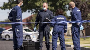 Police near the scene of a 2018 murder.
