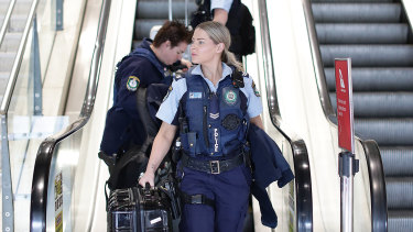 Police arrive at Sydney domestic airport on Tuesday.