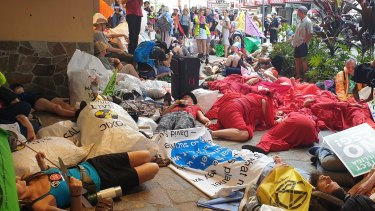 More than 100 activists were protesting outside of the Santos building on Tuesday.