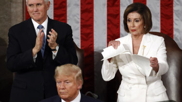 House Speaker Nancy Pelosi tears her copy of President Donald Trump's 2020 State of the Union address after he delivered it to a joint session of Congress.