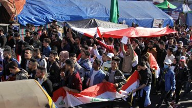 Anti-government protesters gather in Tahrir Square during a sit-in in Baghdad, Iraq.
