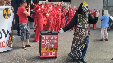 Extinction Rebellion activists were protesting outside of the Santos building in Brisbane on Tuesday, October 8 in Queensland.