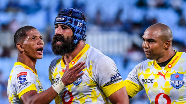 Josh Strauss of the Bulls celebrates with teammates after a try to Rosko Specman against the Highlanders.