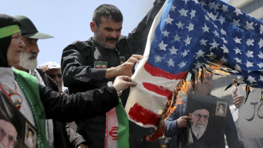 Iranian worshippers burn a US flag during a rally after Friday prayer in Tehran.