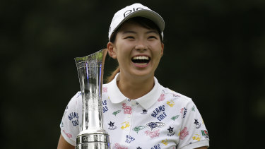 Japan's Hinako Shibuno is all smiles with the trophy after winning the Women's British Open.