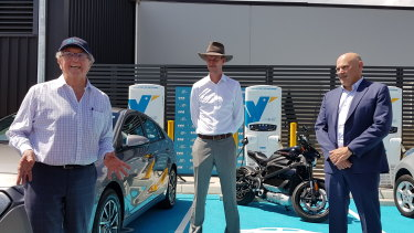(From left) Evie Networks chairman Trevor St John with Transport Minister Mark Bailey and Martin Ryan from Brisbane Airport Corporation with the new charging stations.