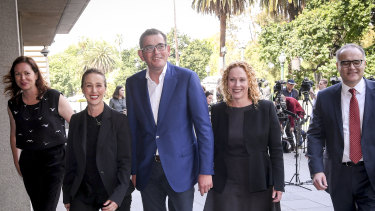 Premier Daniel Andrews (centre) with new members of his ministry - Jaclyn Symes, Gabrielle Williams, Melissa Horne and Adem Somyurek.