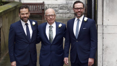 Media Mogul Rupert Murdoch poses for a photograph with his sons Lachlan and James.