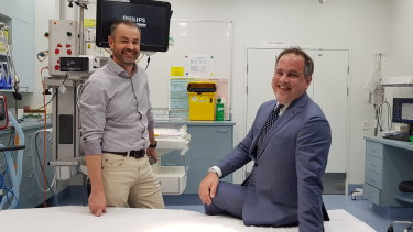 A result to smile about - Chris Gilmour (right) has made a full recovery after being treated by Dr David Rosengren and the RBWH team.