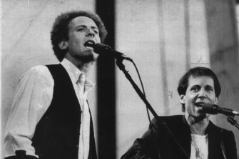 Art Garfunkel and Paul Simon perform for about 400,000 fans in Central Park.