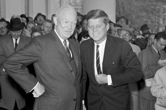 President Dwight Eisenhower and President-elect John F. Kennedy are pictured at the White House in December 1960.
