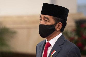 Indonesian President Joko Widodo wears a mask as a precaution against coronavirus on April 30.
