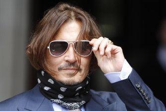 "Johnny Depp arrives at the High Court in London on Friday. He is suing the publisher of The Sun newspaper for depicting him as a ""wife beater""."
