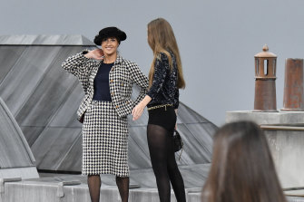 Gigi Hadid escorted the runway intruder off stage.