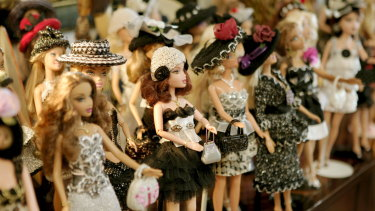 A line-up of Barbie dolls