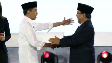 Indonesian President Joko Widodo, left, and his contender Prabowo Subianto.