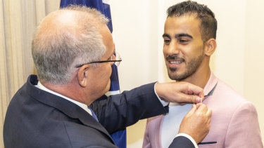 Prime Minister Scott Morrison with Hakeem Al-Araibi following the footballer's release from detention in Thailand in March.