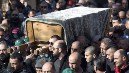 'She is home': thousands of mourners lay Aiia Maasarwe to rest in home city