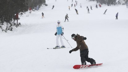 'Lovely to have a ski season opening with snow': NSW slopes blanketed white