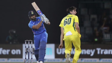 India's Rohit Sharma plays a shot as Australia's Jhye Richardson looks on.