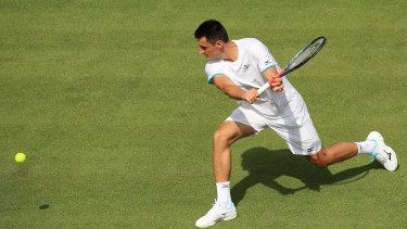 Bernard Tomic's Wimbledon campaign took less than an hour to fizzle out in a straight-sets loss to Jo-Wilfried Tsonga.