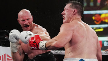 Barry Hall lands a blow on Paul Gallen in Melbourne on Friday night.
