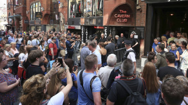 Fans queue outside the Cavern Club before an one-off gig by Sir Paul McCartney in 2018.
