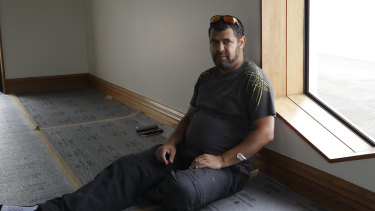 Survivor Tariq Chenafa sits by the the window he smashed to escape the gunman at the mosque in Christchurch, New Zealand.