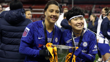 Sam Kerr and Ji So-yun of Chelsea celebrate with the trophy following the FA Women's Continental League Cup final in Nottingham.