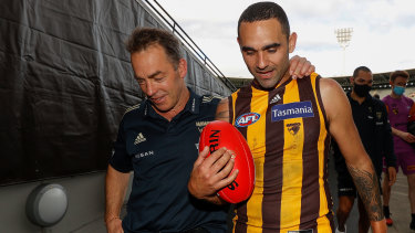 Alastair Clarkson and Shaun Burgoyne leave the MCG for the final time in Hawthorn colours.