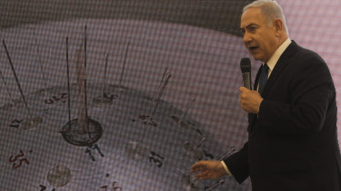 Israeli Prime Minister Benjamin Netanyahu presents material on Iranian nuclear weapons development.