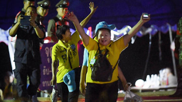 Thai volunteers cheer and yell 'hooray' as they return from Tham Luang cave after all 13 have been rescued.