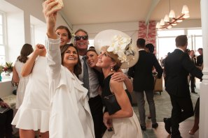 Up close and personal, the good old days: Then deputy PM Julie Bishop and her partner David Panton pose for a selfie with TV host Lisa Wilkinson and friends in the Emirates marquee on Derby Day 2017.