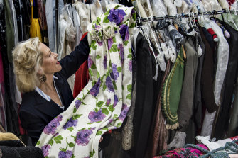 Charlotte Smith holds a 1950s dress that will be part of the sale.