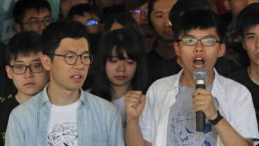 Hong Kong activists Joshua Wong, right, and Nathan Law, left, speak outside court in 2017.