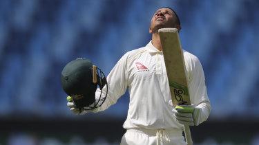 Digging in: Usman Khawaja celebrates his century against Pakistan.