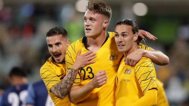 Harry Souttar of the Socceroos celebrates scoring a goal against Nepal.