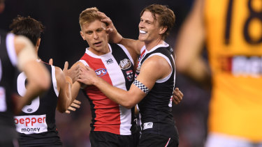 St Kilda's Seb Ross (second from left), who picked up 39 touches against Hawthorn on Sunday, celebrates a goal.