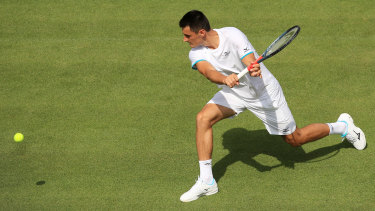 'Unwell': Bernard Tomic's Wimbledon campaign took less than an hour to fizzle out in a straight-sets loss to Jo-Wilfried Tsonga.