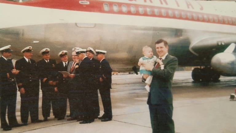 Brian Van de Water holds his daughter Sandra at the  Boeing Plant, in August 1959, as the first Boeing 707 was handed over to Qantas for delivery to Australia.