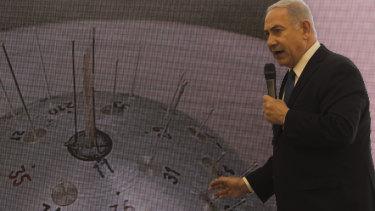 Israeli Prime Minister Benjamin Netanyahu presents material on Iranian nuclear weapons development.