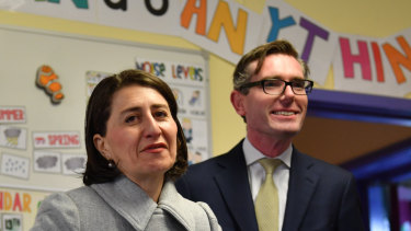 NSW Premier Gladys Berejiklian and Treasurer Dominic Perrottet attend a pre-budget education announcement on Monday.