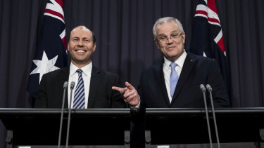 Josh Frydenberg and Scott Morrison address the media on Friday.
